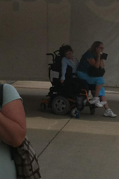 Despicable woman sits on girl in wheelchair