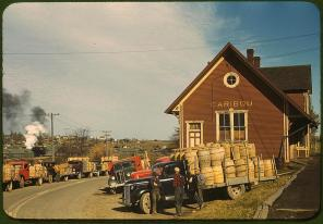 Trucks outside of a starch factory. Caribou, Aroostook County, Maine, October 1940. Reproduction from color slide. Photo by Jack Delano. Prints and Photographs Division, Library of Congress