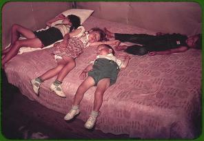 Children asleep on bed during square dance. McIntosh County, Oklahoma, 1939 or 1940. Reproduction from color slide. Photo by Russell Lee. Prints and Photographs Division, Library of Congress