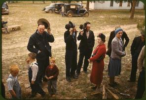 Saying grace before the barbeque dinner at the New Mexico Fair. Pie Town, New Mexico, October 1940. Reproduction from color slide. Photo by Russell Lee. Prints and Photographs Division, Library of Congress
