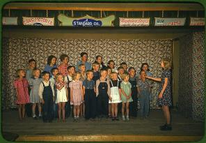 School children singing. Pie Town, New Mexico, October 1940. Reproduction from color slide. Photo by Russell Lee. Prints and Photographs Division, Library of Congress