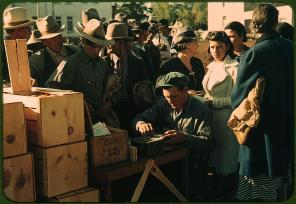 Distributing surplus commodities. St. Johns, Arizona, October 1940. Reproduction from color slide. Photo by Russell Lee. Prints and Photographs Division, Library of Congress