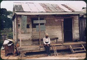 A store with live fish for sale. Vicinity of Natchitoches, Louisiana, July 1940. Reproduction from color slide. Photo by Marion Post Wolcott. Prints and Photographs Division, Library of Congress