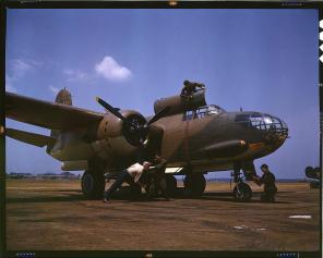 Servicing an A-20 bomber. Langley Field, Virginia, July 1942. Reproduction from color slide. Photo by Alfred T. Palmer. Prints and Photographs Division, Library of Congress
