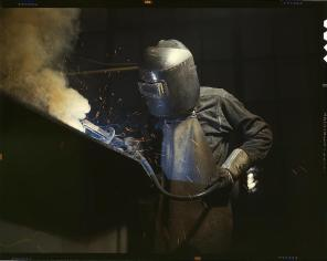 Welder making boilers for a ship, Combustion Engineering Company. Chattanooga, Tennessee, June 1942. Reproduction from color slide. Photo by Alfred T. Palmer. Prints and Photographs Division, Library of Congress