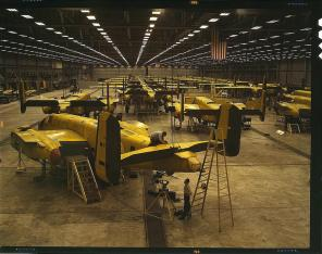 Assembling B-25 bombers at North American Aviation. Kansas City, Kansas, October 1942. Reproduction from color slide. Photo by Alfred T. Palmer. Prints and Photographs Division, Library of Congress
