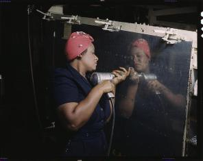 """Woman is working on a """"Vengeance"""" dive bomber Tennessee, February 1943. Reproduction from color slide. Photo by Alfred T. Palmer. Prints and Photographs Division, Library of Congress"""